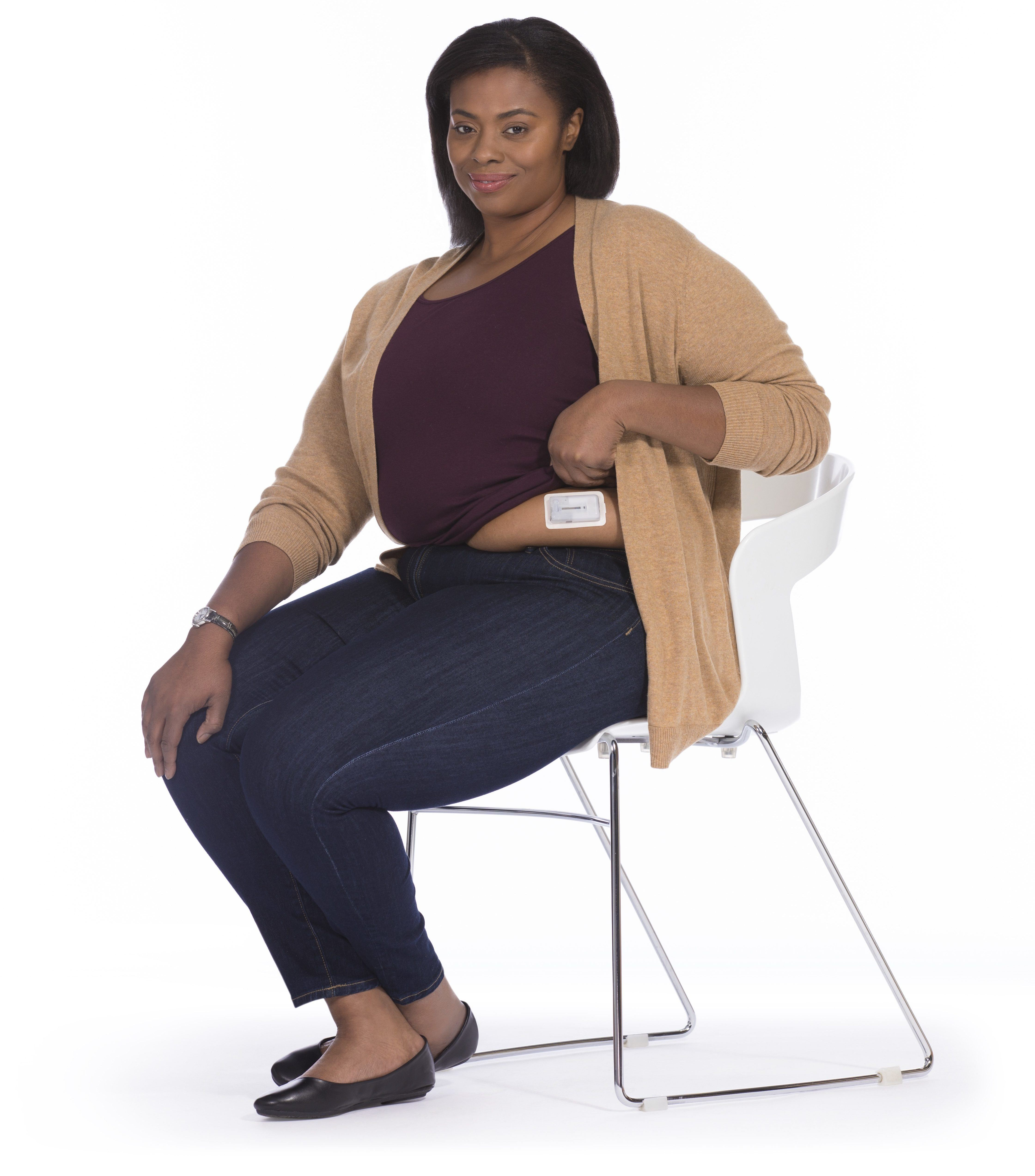 Woman modeling the V-Go® device