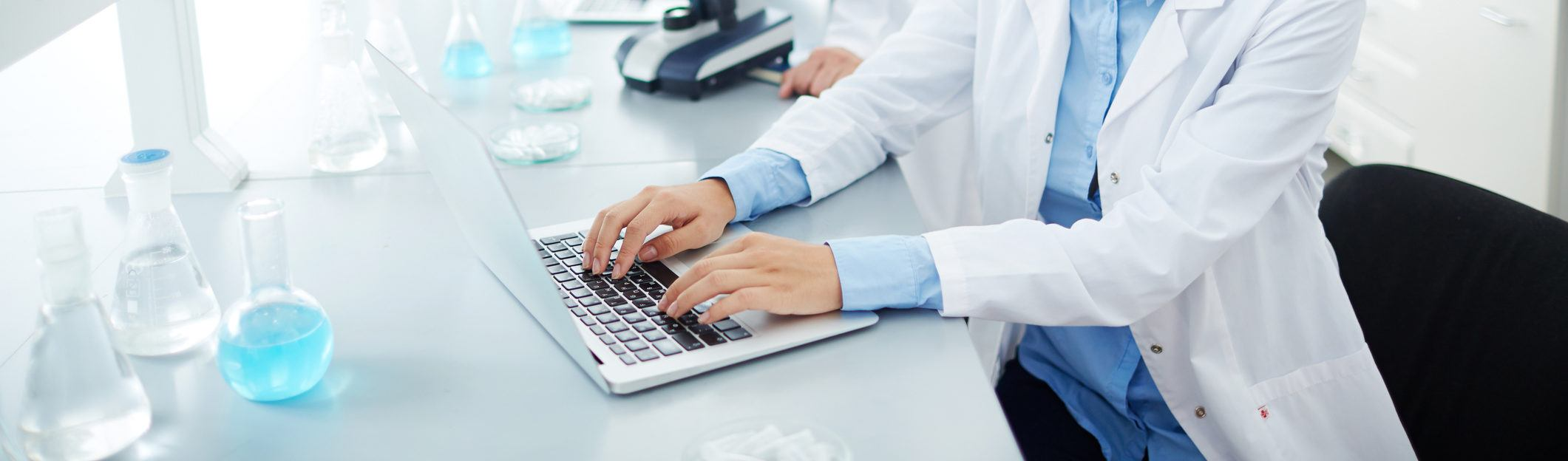 Doctor typing in laboratory