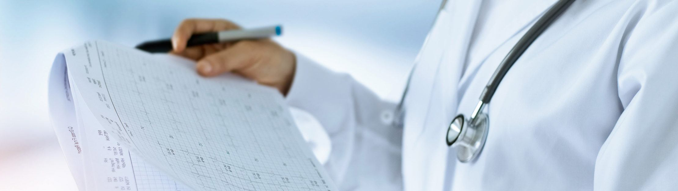 Doctor reading hospital reports